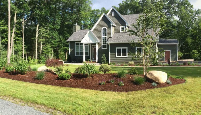 A planted berm for a newly constructed home