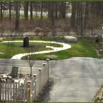 The sculpture garden path with a sitting rock