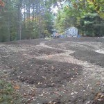 Earthen berms for the Discovery Garden installed, ready for planting